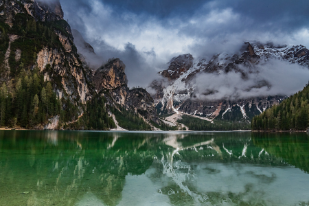 Dramatic clouds over Pragser Wildsee in Dolomites, Italy Stock Photo - 107200026