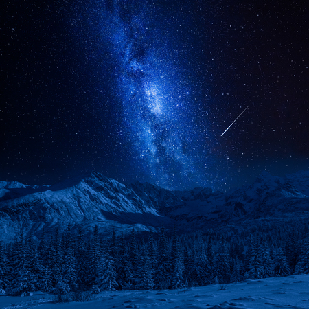 Falling star and Tatras Mountains in winter at night, Poland Stock Photo