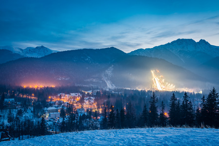 Winter skiing competitions at dusk in winter in Zakopane, Poland Stock Photo