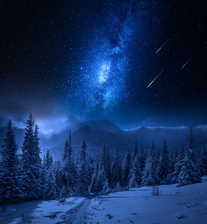Tatras Mountains in winter at night with falling stars, Poland Stock Photo
