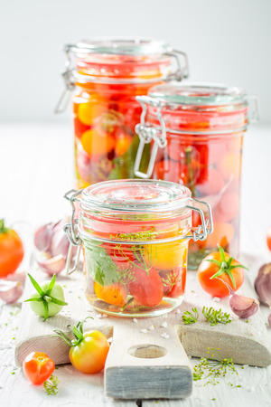 Preparation for fresh pickled red tomatoes in summer