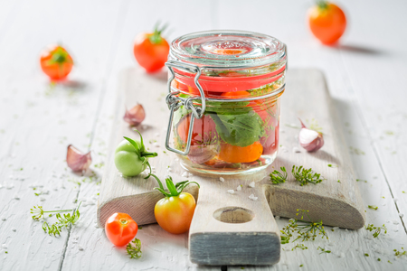Homemade and tasty pickled red tomatoes in summer