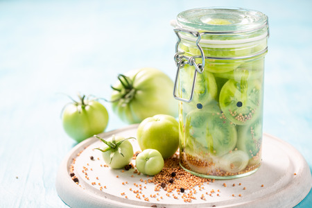 Fresh ingredients for pickled green tomatoes in the jar
