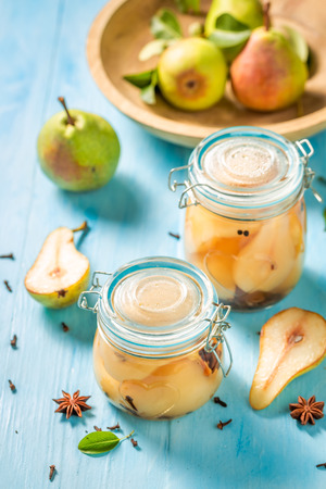 Ingredients for fresh pickled pears on blue table Banco de Imagens - 107639856