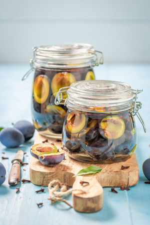 Preparation for fresh canned purple plums in the jar Banco de Imagens - 107639860