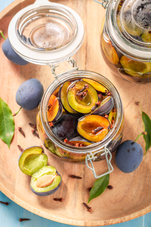 Preparation for fresh canned purple plums in the jar Banco de Imagens
