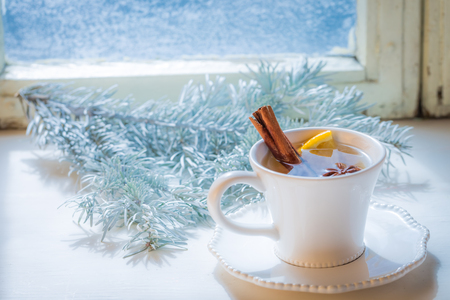 Sweet and aromatic tea with cinnamon for Christmas Stock Photo