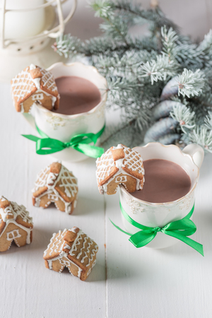 Sweet gingerbread cottages with hot chocolate for Christmas
