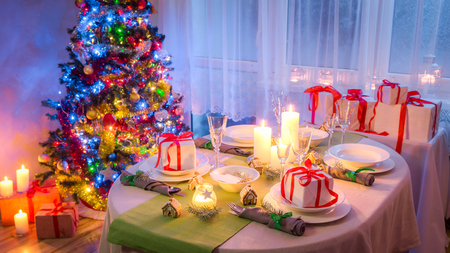 Stunning Christmas table setting with candles and gingerbread Stock Photo