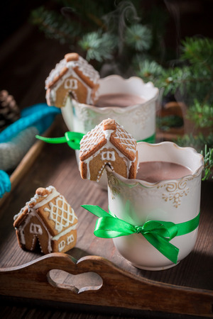 Closeup of gingerbread cottages and hot cocoa for Christmas