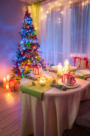 Colorfuk Christmas table setting with gifts for Christmas eve