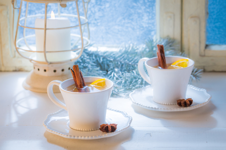 Hot tea with cinnamon for Christmas on white table Stock Photo