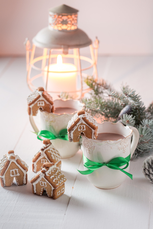 Gingerbread cottages with hot cocoa for Christmas