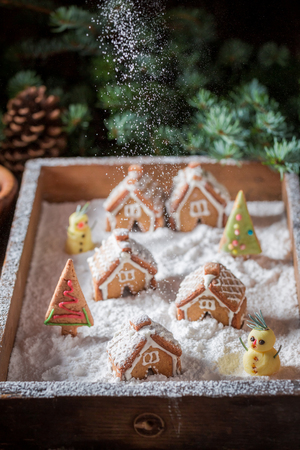 Falling snow on Christmas small gingerbread village