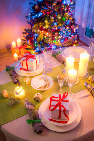 Christmas table setting with green and white decoration