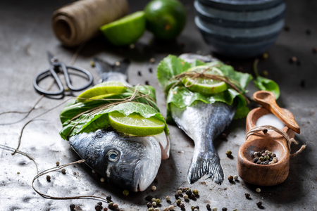 Freshly caught sea bream with lime and horseradish leaves