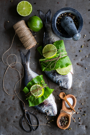 Preparing whole fish with salt and pepper