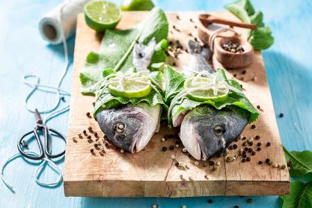 Freshly caught whole fish with horseradish and lemon Stock Photo - 108517673