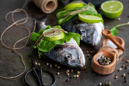 Preparing sea bream with lime and horseradish leaves