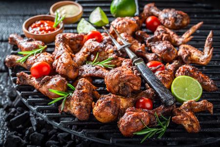 Spicy grilled chicken leg on metal grate Stock fotó