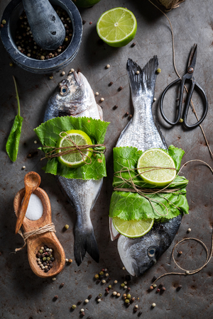 Freshly caught whole fish with lime and horseradish leaves
