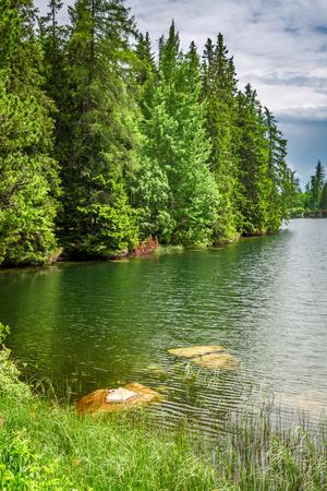 Stunning mountain lake in Strbske Pleso in theTatra mountains Stockfoto