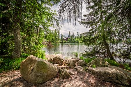 Wonderful mountain lake in Strbske Pleso in theTatra mountains 스톡 콘텐츠