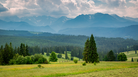 Cloudy Tatra mountains at sunset in summer