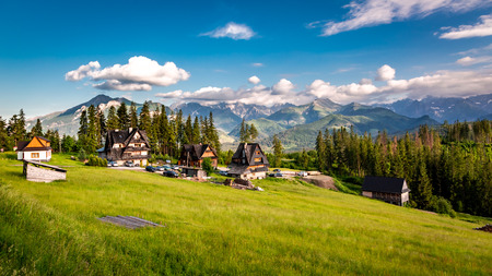 Few houses and wonderful Tatra mountains at sunset in summer Stok Fotoğraf - 108517855