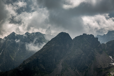 Cloudy peaks of mountains, view from Kasprowy Wierch to Åšwinica