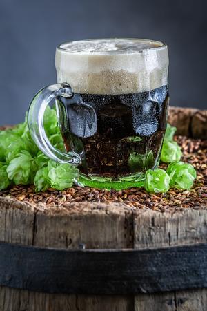 Fresh pint of dark beer with white foam