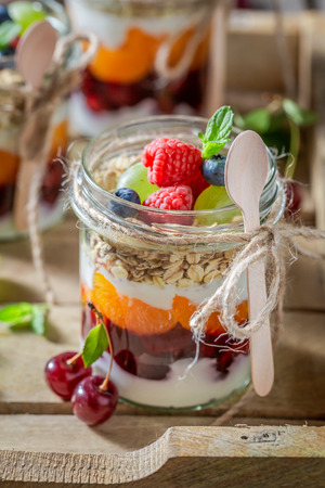 Fresh oat flakes in jar with yogurt and berry fruits Stock Photo