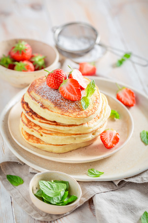 Tasty american pancakes for breakfast on white table