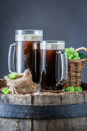 Fresh dark beer with white foam and ingredients Stock fotó