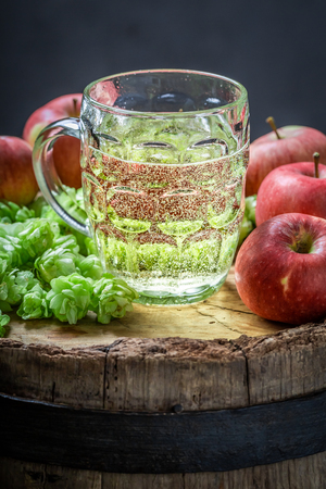 Cold cider beer with wheat, hops and apples Stock Photo