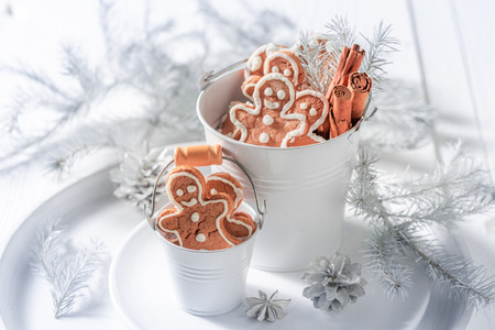Sweet Christmas gingerbread man in white bucket