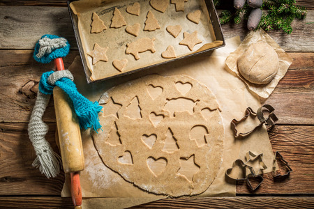 Top view of gingerbread cookies for Christmas on baking tray