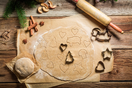 Preparation for baking Christmas cookies on rustic table
