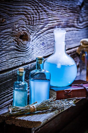 Closeup of magical blue potions on wooden shelf for Halloween 版權商用圖片