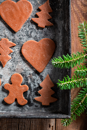 Closeup of sweet gingerbread cookies for Christmas on baking paper