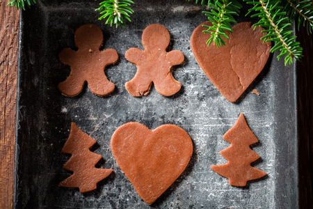 Brown Christmas gingerbread cookies in baking tray