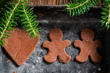 Before baking Christmas gingerbread cookies on baking tray Stock Photo