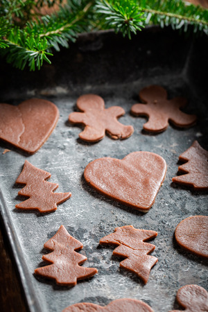 Preparation for baking Christmas gingerbread cookies on baking tray