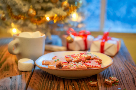 Sweet gingerbread cookies, hot chocolate and Christmas tree