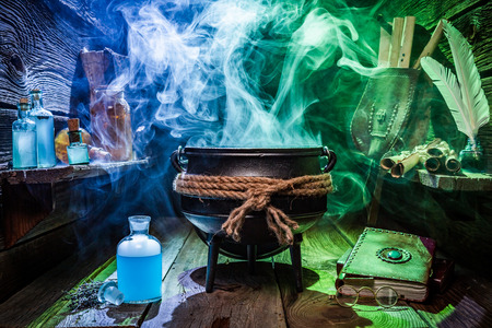Witcher cauldron with magic potions and books for Halloween