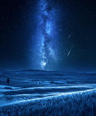 Milky way and falling stars in Tuscany at night, Italy
