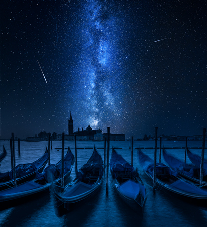 Swinging gondolas in Venice and milky way with falling stars