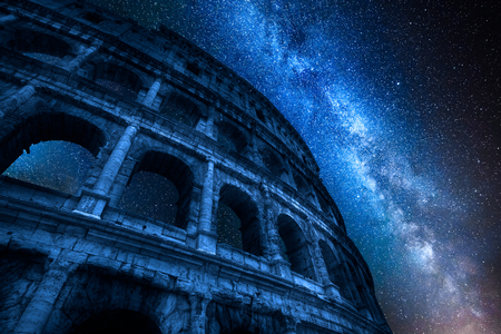 Milky way and Colosseum at night in Rome, Italy