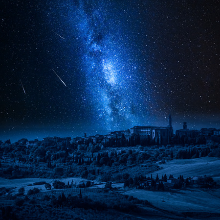 Pienza at night with milky way and falling stars, Tucany