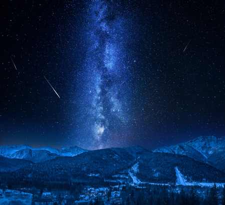 Zakopane with milky way and falling stars in winter Stock Photo